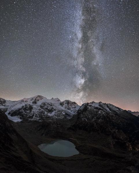 Milky way above mountain lake