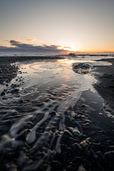 Sunrise above glacial pond