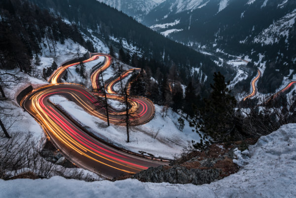 Light trails on winding mountain road