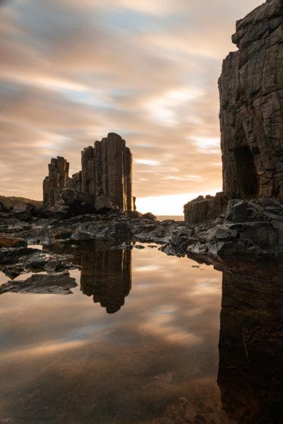 Golden hour long exposure with basalt columns