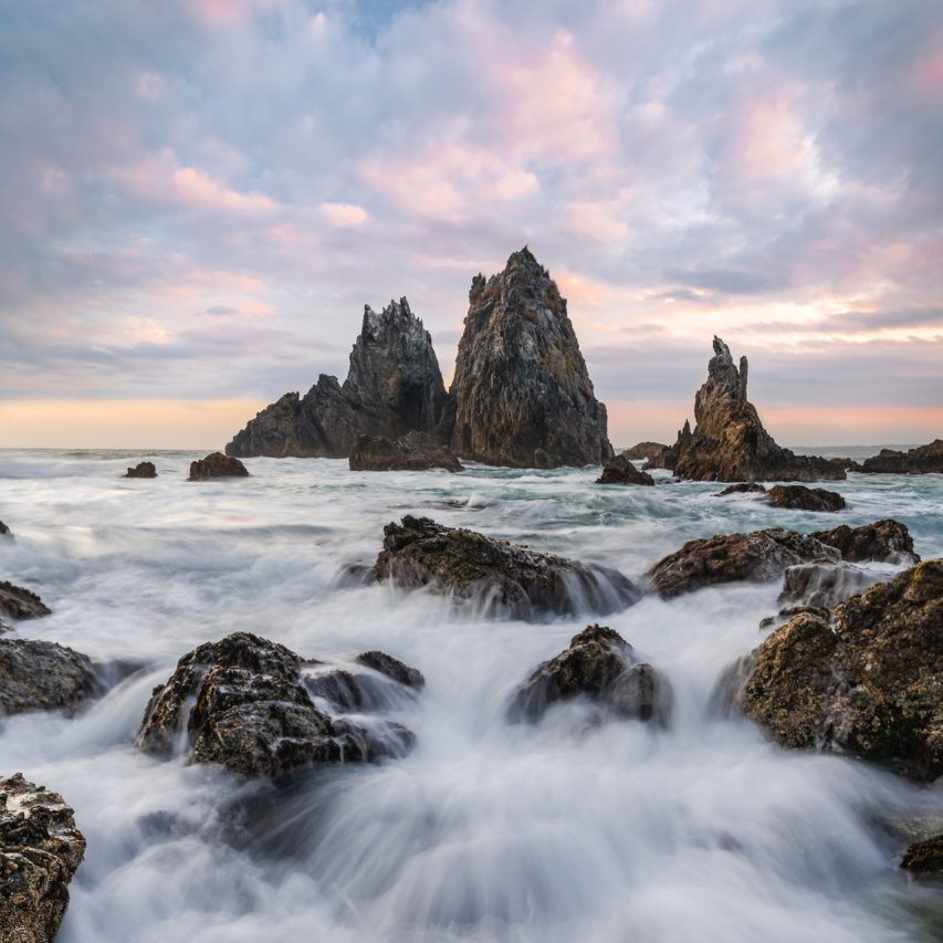 Golden hour seascape with rock formations