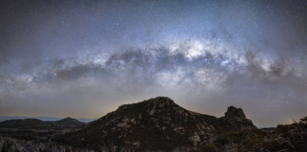 Milky way arch above mountain