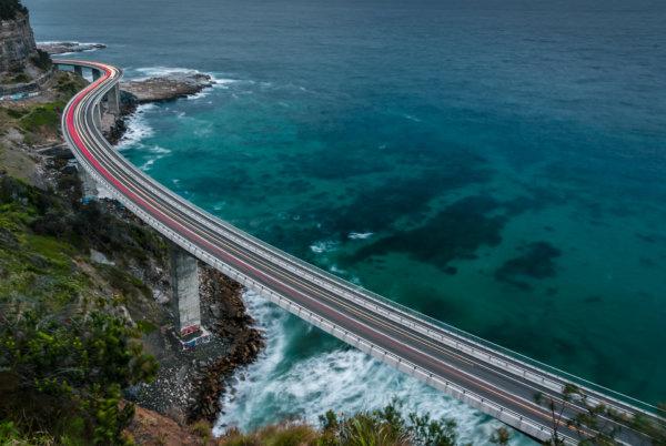 Light trails on seaside bridge