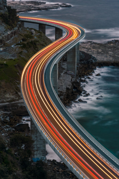 Light trails on seaside bridge
