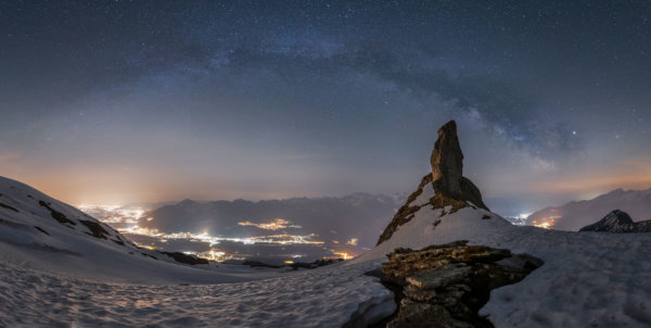 Full milky way arch above rock spire