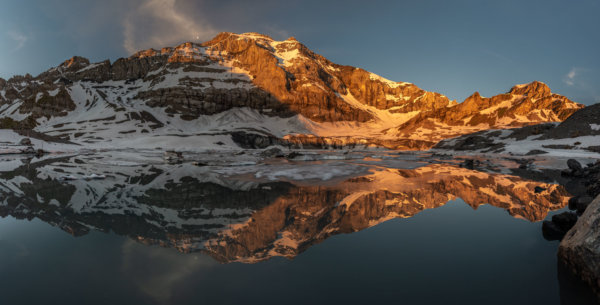 Alpenglow glacial lake reflection