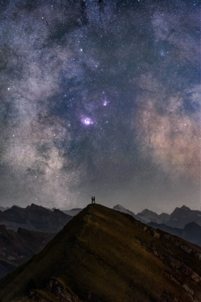 Couple in the center of the milky way