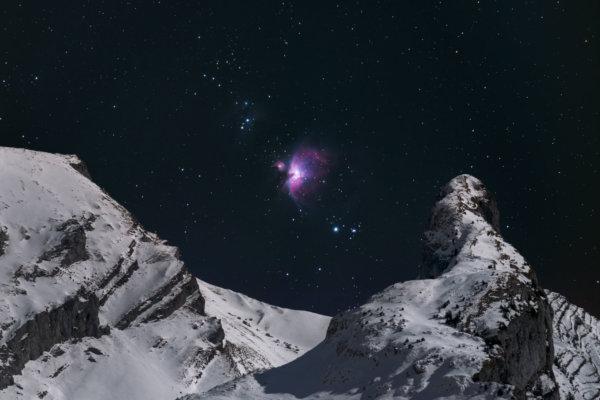 Great Orion Nebula above mountain peak