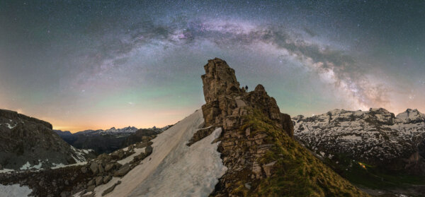 Milky Way Panorama Above Snowy Rock Formation