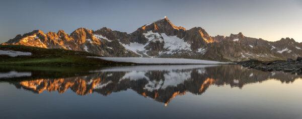 Sunrise Panorama of Mountain Lake Reflection