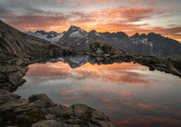 Glowing Clouds at Sunrise Reflected in Mountain Lake